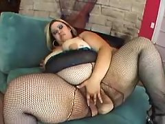 Flabby mature in red stockings spoils amateur dude