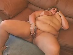 Elephant size lady plays with dildo