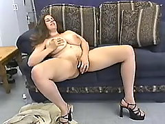 Plump woman plays with green dildo